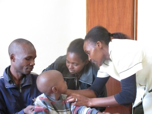 Elizabeth doing a hearing aid orientation for Esther and her family